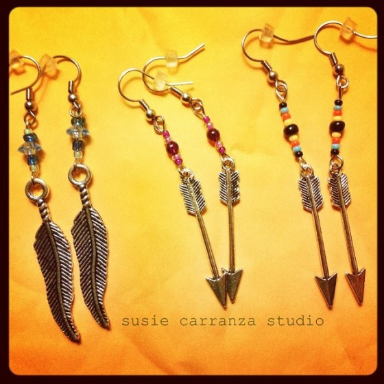 earrings: feathers and arrows