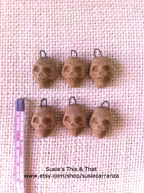 miniature clay skulls...