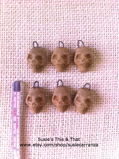 miniature clay skulls...
