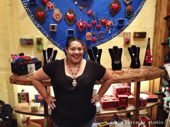 Lizzy Hernandez of Inspira, displaying her jewelry at Hecho con Carino on Olvera Street...