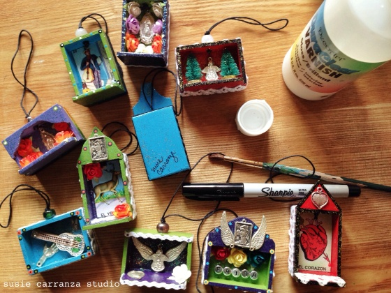 signing and varnishing my mini ornaments before sending to their new homes...