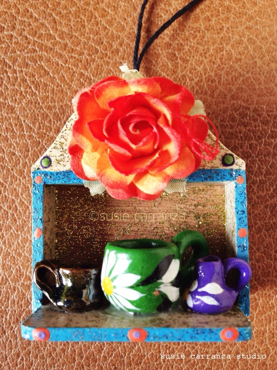 ornament: large orange rose with miniature clay pottery...