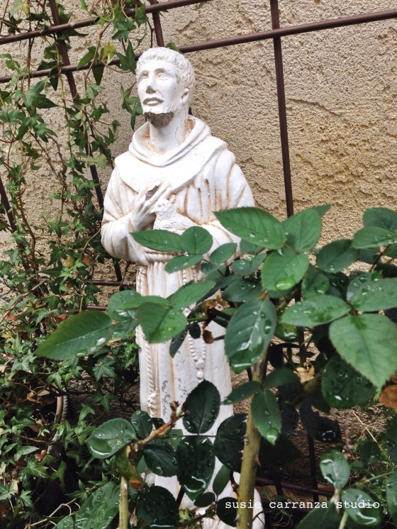 St. Francis statue after a rainfall. susie carranza studio