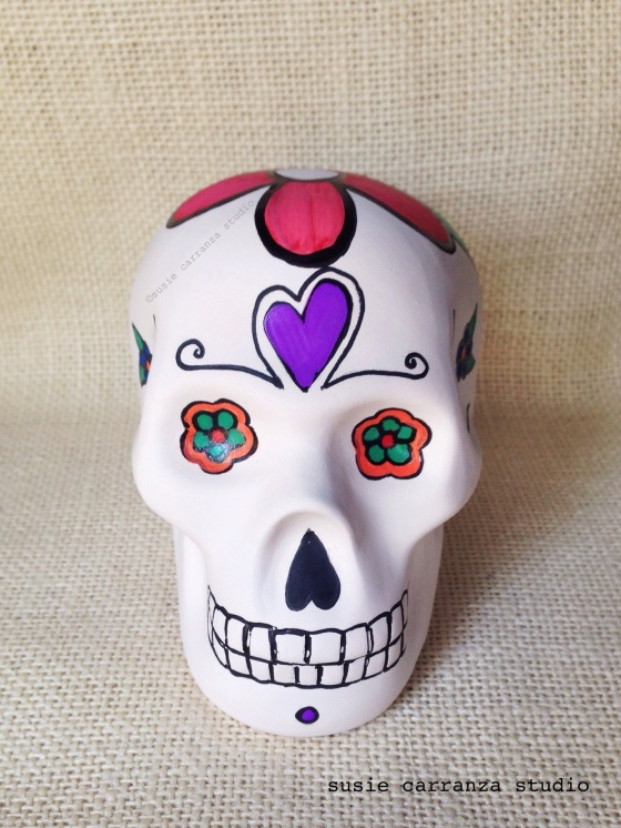 one of my hand painted ceramic skulls - what do you think?