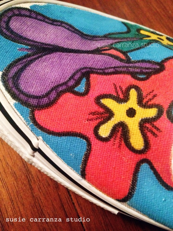 Close up of hand painted canvas shoes - susie carranza studio