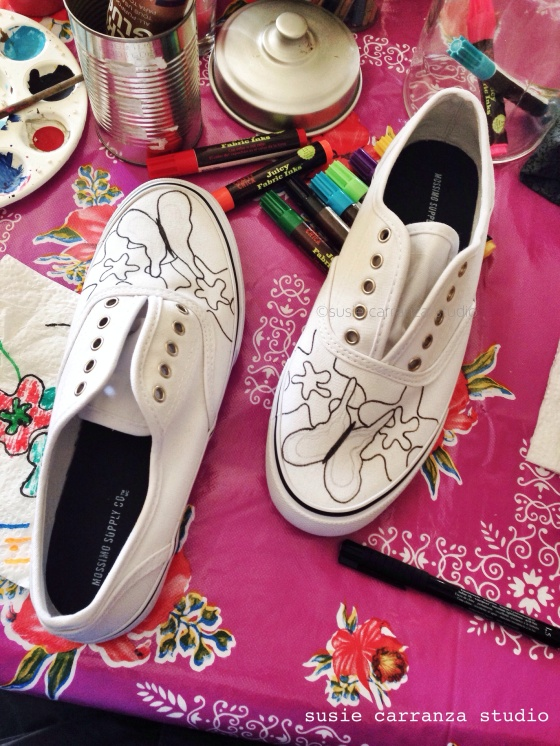 Drawing butterflies and flowers on canvas shoes - susie carranza studio