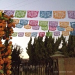 Gorgeous papel picado, entrance to San Gabriel Mission Cemetery - susie carranza studio