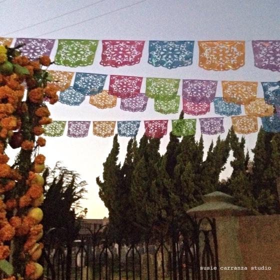 Gorgeous papel picado, entrance to San Gabriel Mission Cemetery - susie carranza studio