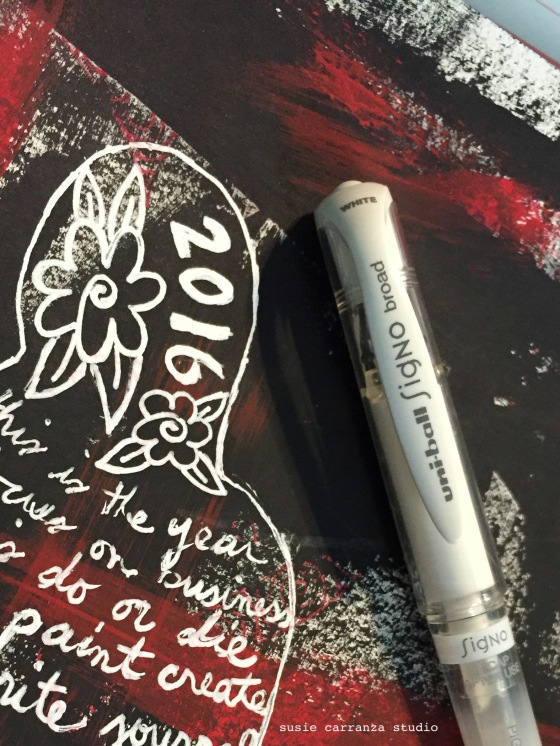 one of my favorite tools: my Signo white ink pen!